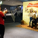 Fans enjoying the Budweiser country photo booth.