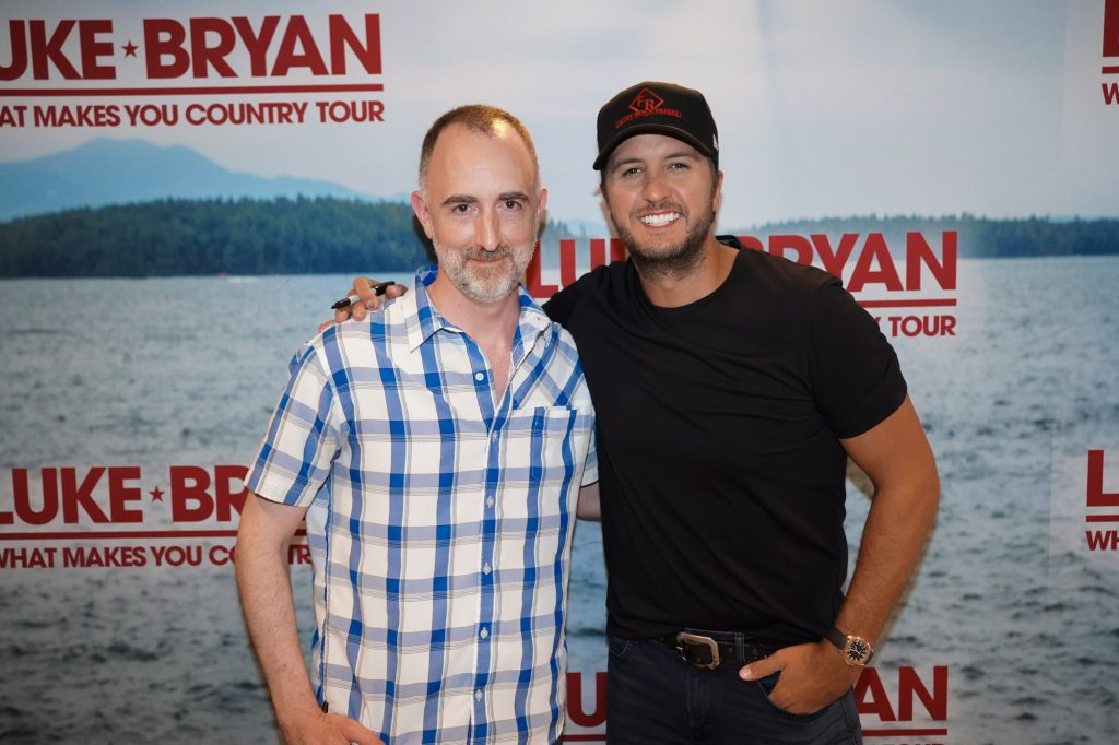 The Country Scene's Shawn St. Jean with Luke Bryan in Bristow VA